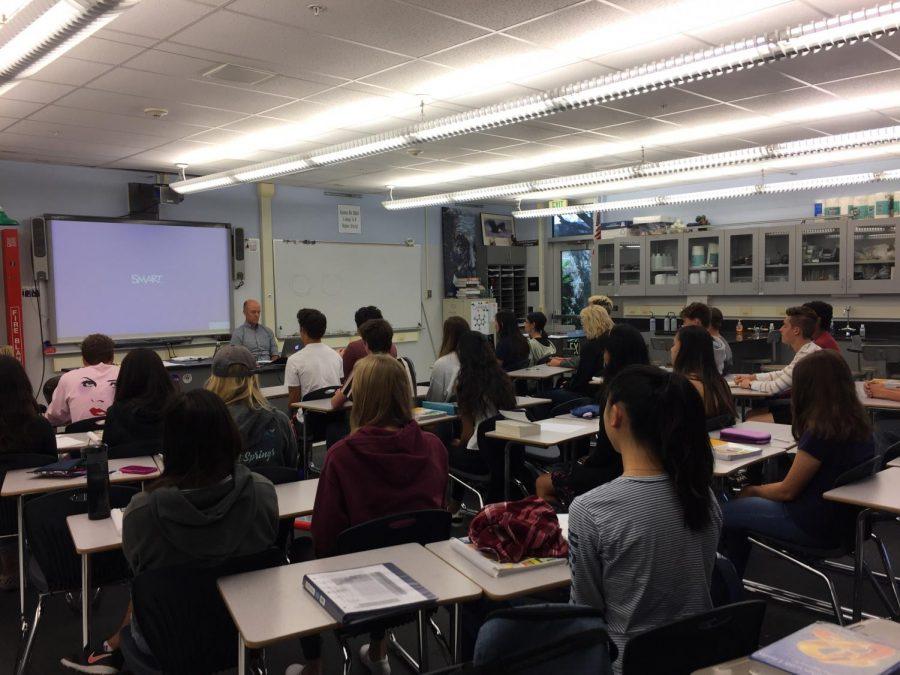 Sloan incorporates meditation into his classes