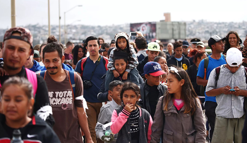Members of a caravan of migrants from Central America walk towards the United States border and customs facility in Tijuana, Mexico, April 29, 2018. (Edgard Garrido/Reuters)