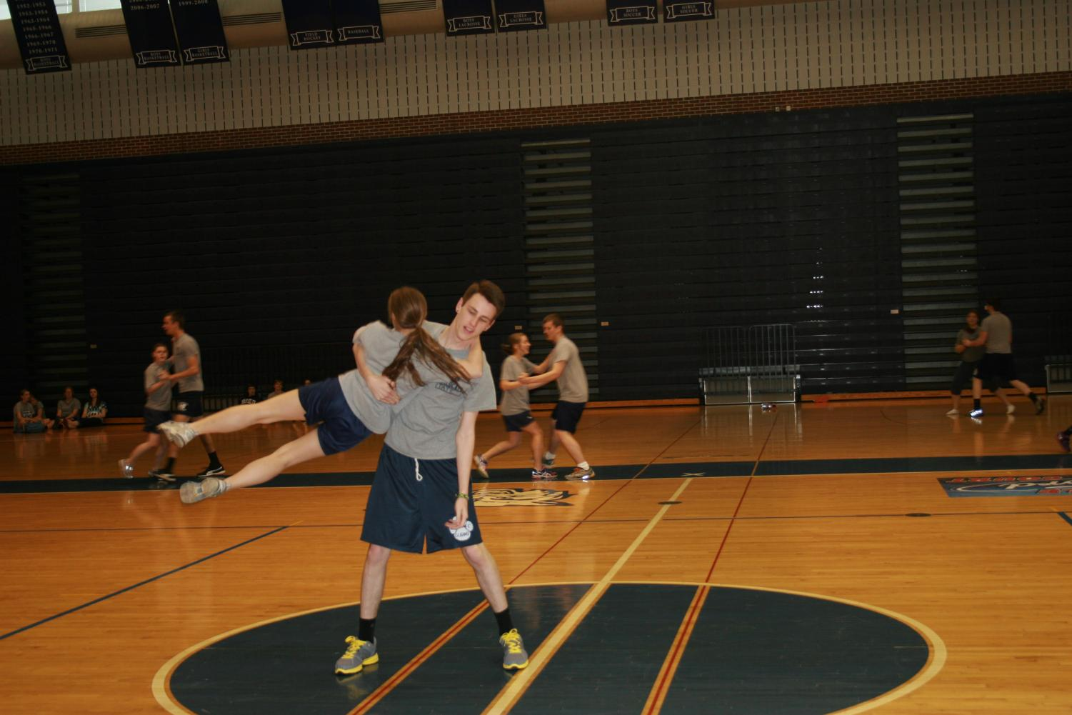 Students swing their partner around them in an effort to impress the polka judges (aka the gym teachers) during the polka unit in gym. Tricks, flips, stunts, and props were often added to routines to make an impression on the dance floor. Students looked forward to the polka unit in gym every year, going all out to become the champions.
