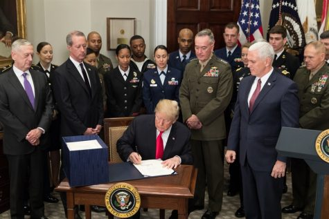 President Donald J. Trump, joined by Vice President Mike Pence and senior military leaders, signs the National Defense Authorization Act for 2018 on Dec. 12, 2017. Due to the Government Shutdown  many United States agencies were without funding for 35 days.