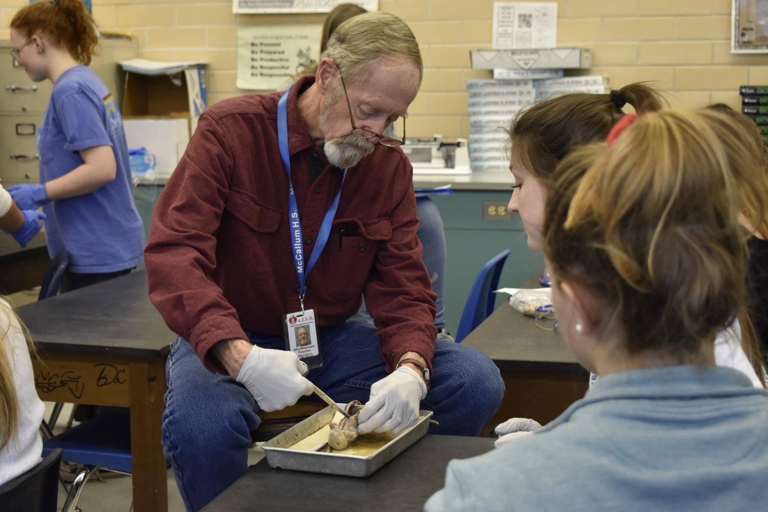 Whisennand helps students with their rat dissections in his Anatomy and Physiology class.
