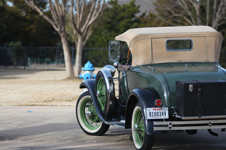 Robert Benson leaves his driveway in his 1931 Roadster.