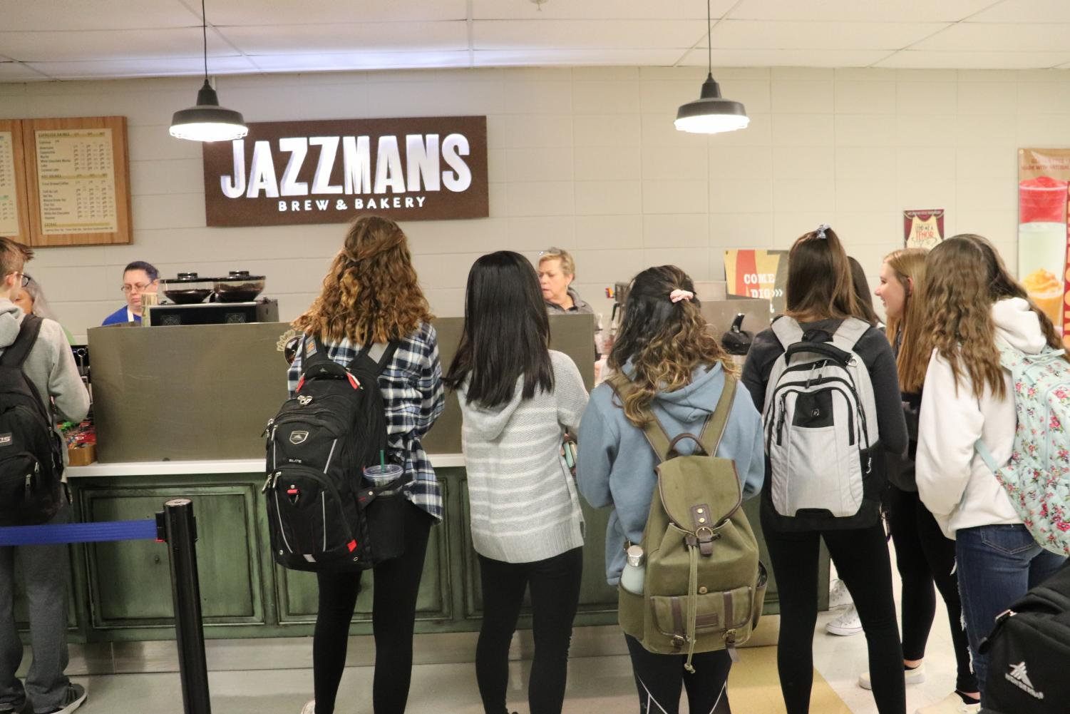 Students wait for their specialized coffee drinks in the morning. Many students say that these complex drink orders can hold up the line and cause irritation among Jazzman's customers.