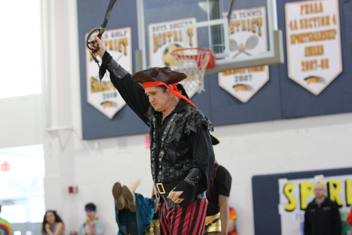 """After being asked by his senior students, social studies teacher David Pardo took on the role of a pirate during the senior skit at Pep Rally. """"I was shocked at how much time and energy was put into [Pep Rally], both by the students and the staff,"""" Mr. Pardo said. Although he enjoyed participating, Mr. Pardo hopes just to be a part of the audience in next year's Pep Rally."""