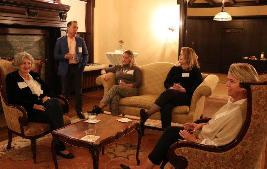Alumni chat at an Associated Alumnae and Alumni of the Sacred Heart meeting in Nov. 2018 at Sacred Heart Schools in Chicago. All alumni of Sacred Heart schools have access to AASH upon graduation.