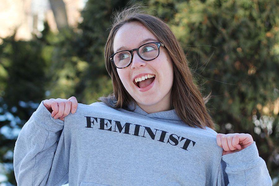 Photo+Editor+Maddi+Shinall+%2719+poses+for+a+photo+as+she+displays+her+feminist+slogan+sweatshirt+on+Friday%2C+Feb.+15.