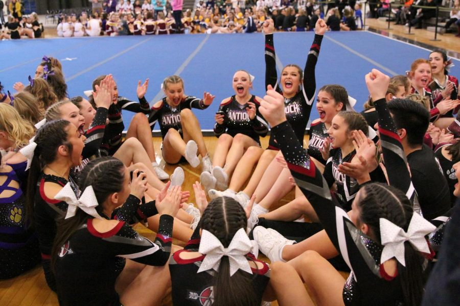 The+varsity+cheer+team+raises+their+hands+in+the+air+in+triumph+as+their+name+was+announced+as+one+of+the+five+teams+to+qualify+for+state