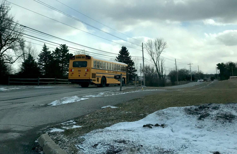 An HSE schools' bus leaves Fishers High School along Hoosier Road on Jan. 29 in freezing temperatures.