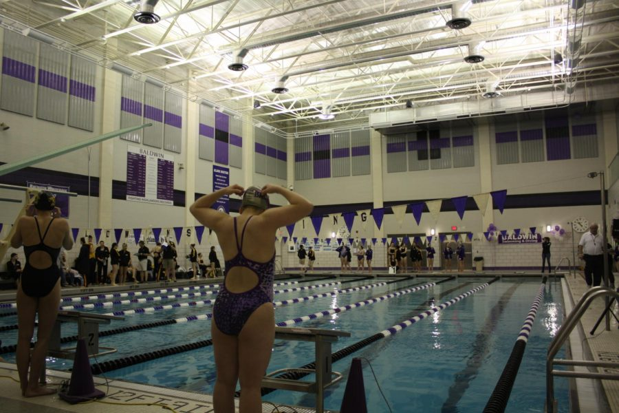 Meyer swims though her last season
