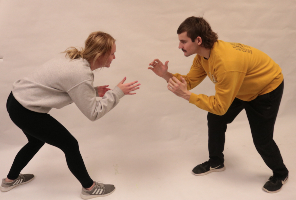 TAKE YOUR STANCE - AHS writer Mia Trotter learns the wrestling stance from senior wrestler Kenny Jimerson.