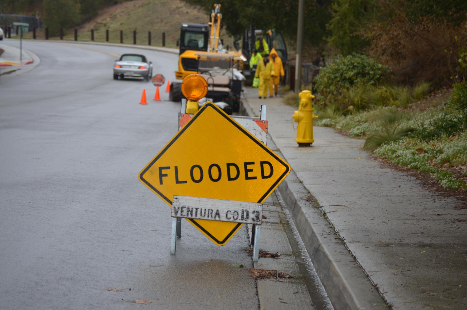 Crews on Hollytree Drive in Oak Park work to block mudslides from impacting roads and houses