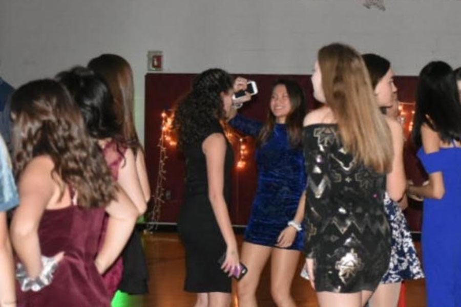 "Students dance at the Harvest Ball in the mini gym on Nov 2. ""There was more effort into planning it, so it's gonna be better,"" Patel stated in the days leading up to the dance. Increased organisation and planning of the dance this year likely increased attendance at the event."