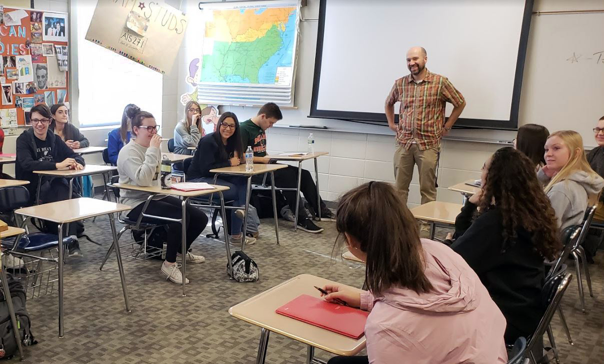 Current American Studies students takes notes during a lecture. The class offers a unique approach to learning, which some believe is being thrown away in the school's push for more APs.