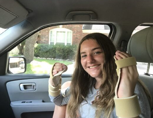 Jacilyn Averill poses with her hand splints after her diagnosis.