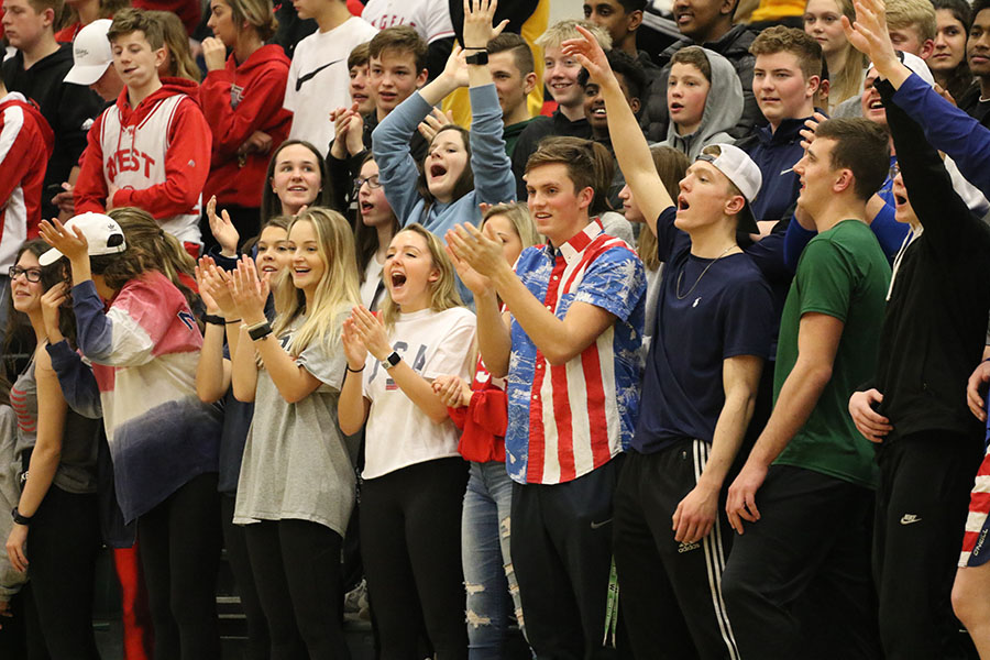 The student section cheers during the first round of regionals for the boys basketball team on Friday, Feb. 22.