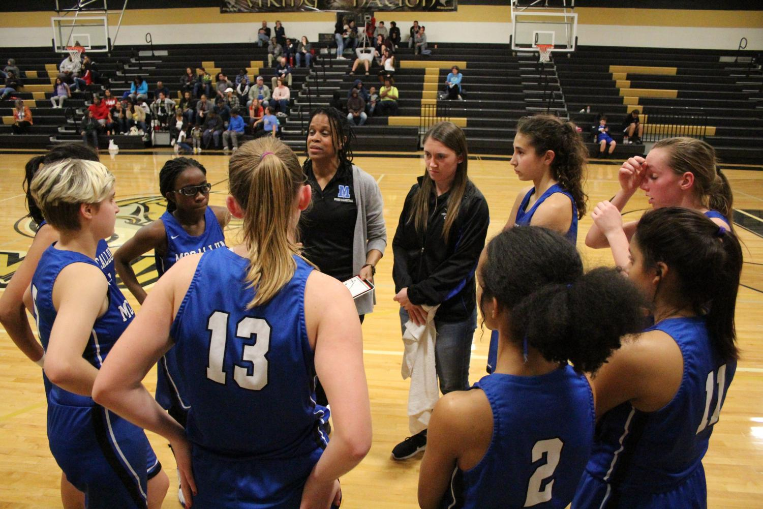 Coach Campbell rallies the troops during a timeout at Lanier, Photo by Selena De Jesus.