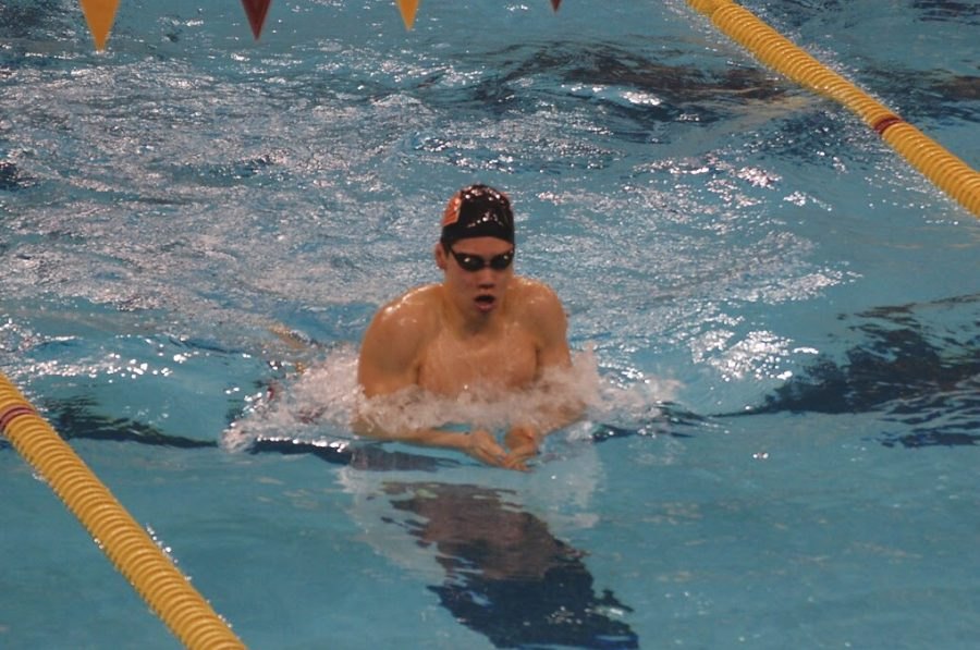 Sophomore+Hayden+Zheng+warms+up+before+he+swims+the+100+breaststroke+at+the+AA+boys%27+swimming+State+meet+March+5+at+the+University+of+Minnesota.+