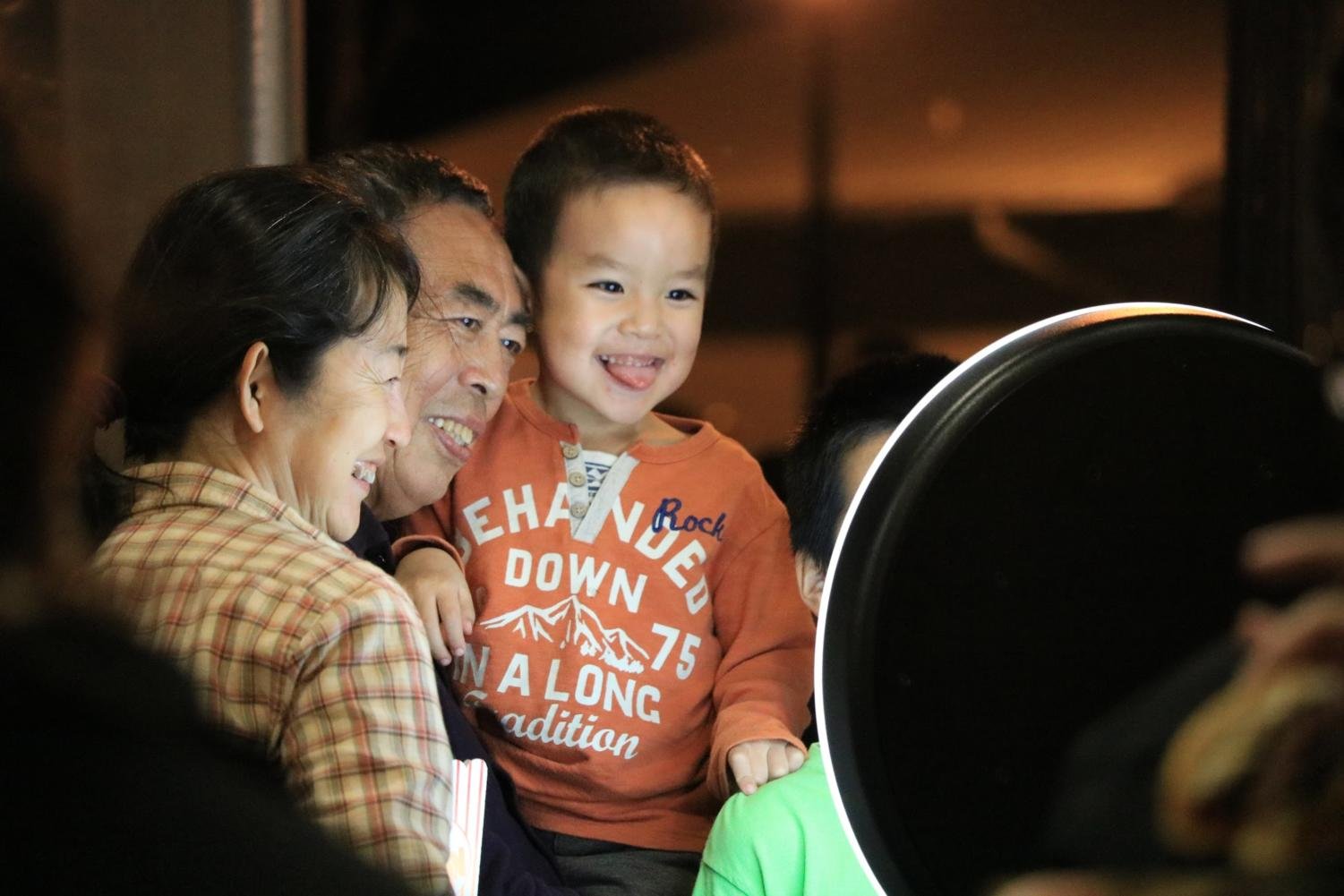 Coppell resident Xiaofangsui and her family take a picture with the selfie station at the Spring Music Series on March 8. The City of Coppell is hosting a series of nights with live music, food trucks and games in Old Town Coppell.