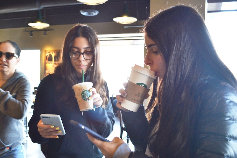 CLOSE:   Starbucks and Coffee Bean are frequented by Shalhevet students throughout the day. Above, juniors Celine Basiratmand (center) and Maital Hiller drank coffee during breakfast Feb 15.