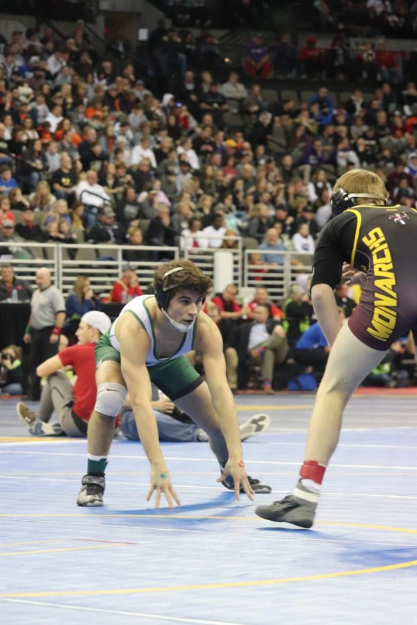 Senior Camden Russell staring down his opponent from Papillion La-Vista High School, Cody Niemiec