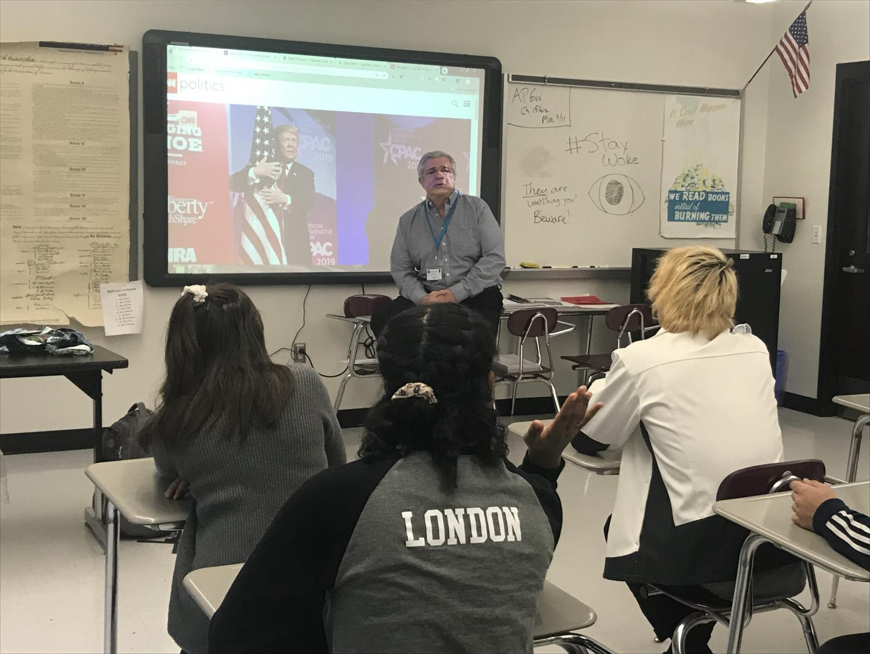 Social studies teacher Mr. Kurnas discusses a political event in the classroom.