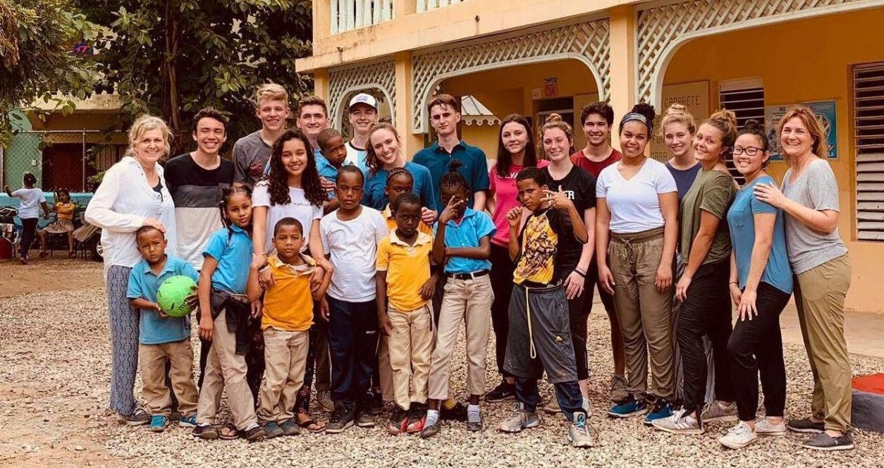 LHS students gather with local children from the Dominican Republic while on a mission trip during February break.