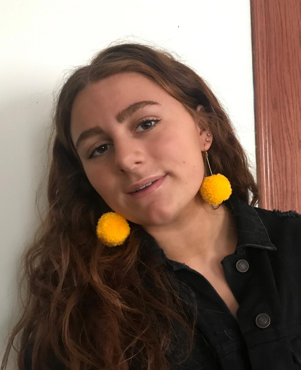Senior Lauren Richter models a pair of her handmade pom pom earrings.