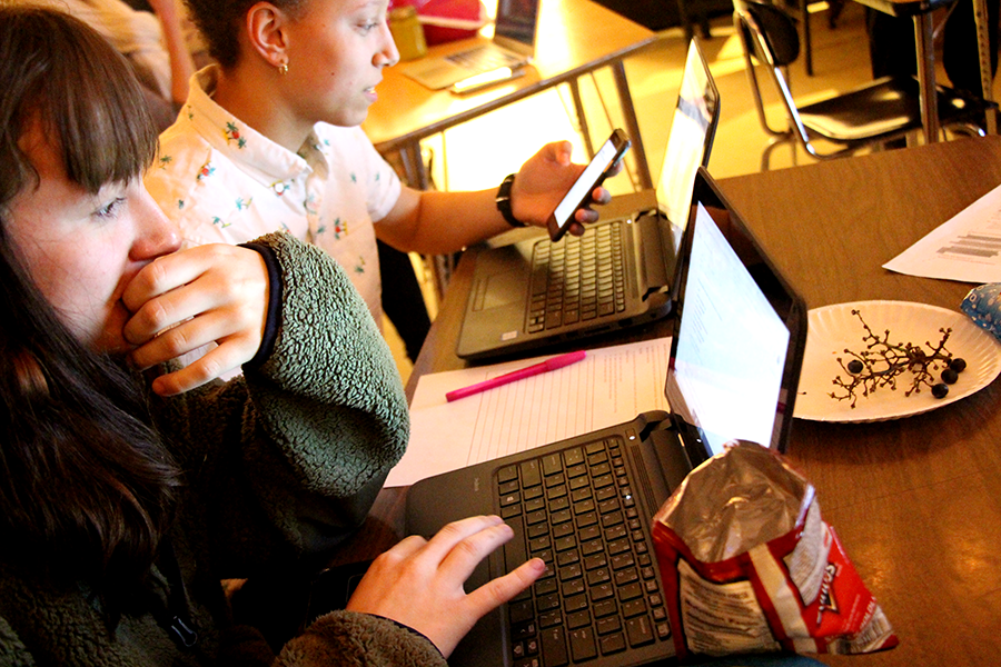 """South juniors Claire Jensen and Kate Rounds work in a session of Sisters-N-Technology. """"I didn't really know a bunch about coding before this. I knew that it was important and I knew that a lot of positions look for things that you can could, especially in technological positions. So I just think its a really valuable skill,"""" said junior Matisse Bolstron."""
