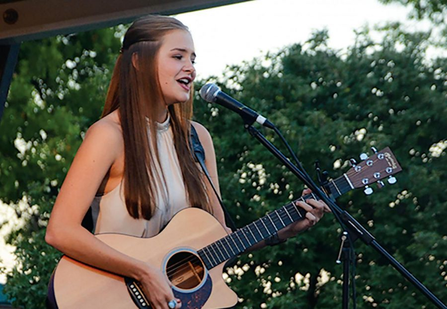 Abbie+Callahan+%2720+performs+at+the+Johnson+County+Fair+talent+show+in+July+2018%2C+placing+first+and+advancing+to+the+Iowa+State+Fair+talent+show.+