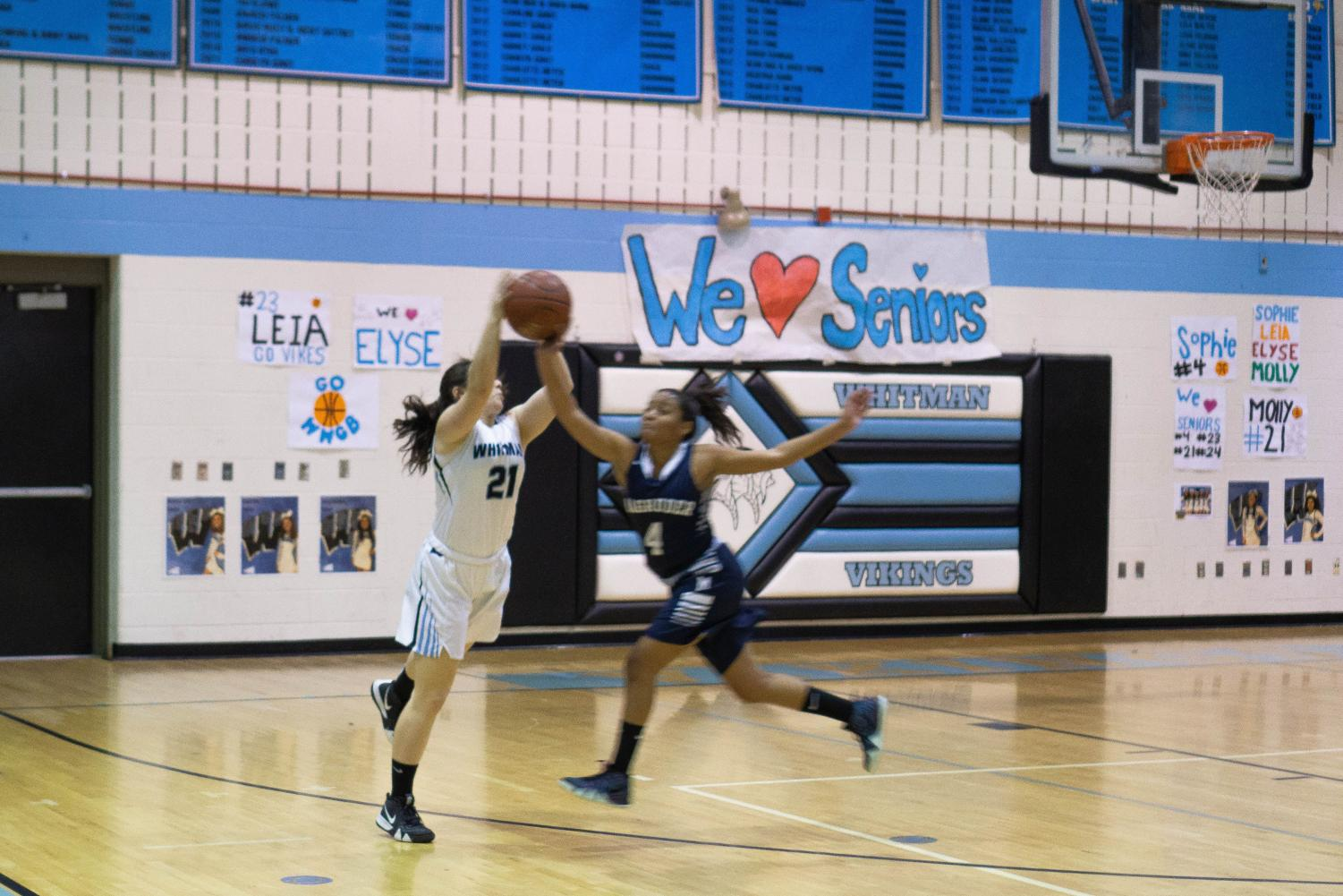 Senior Molly Knox reaches for the ball. Whitman played Magruder on senior night, an annual tradition to honor an end to four years on Whitman basketball.