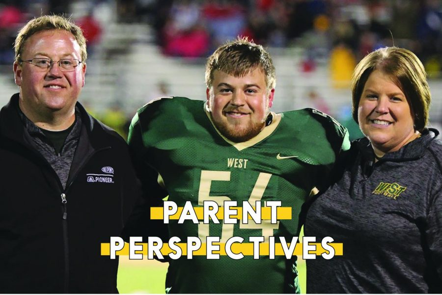 Alex+Boxwell+%2719+stands+with+his+parents+Denise+and+Brian+during+the+West+varsity+football+senior+night+on+Friday%2C+Oct.+19.