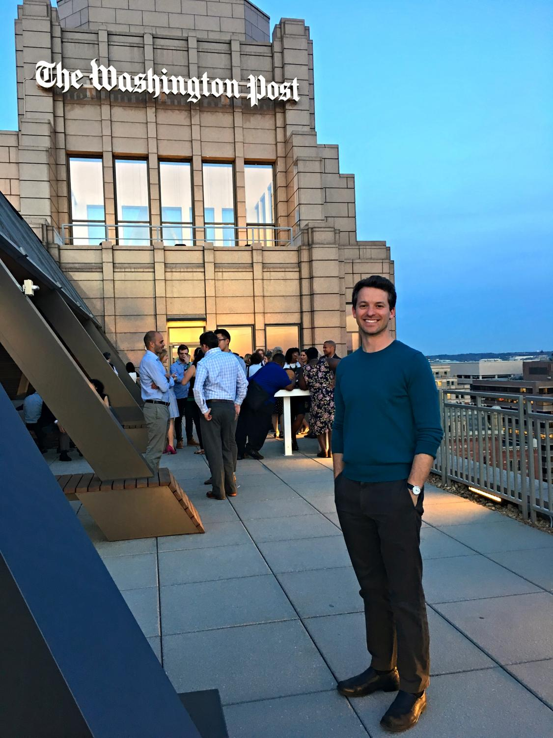 Pincus-Roth poses on the roof of the Washington Post building.