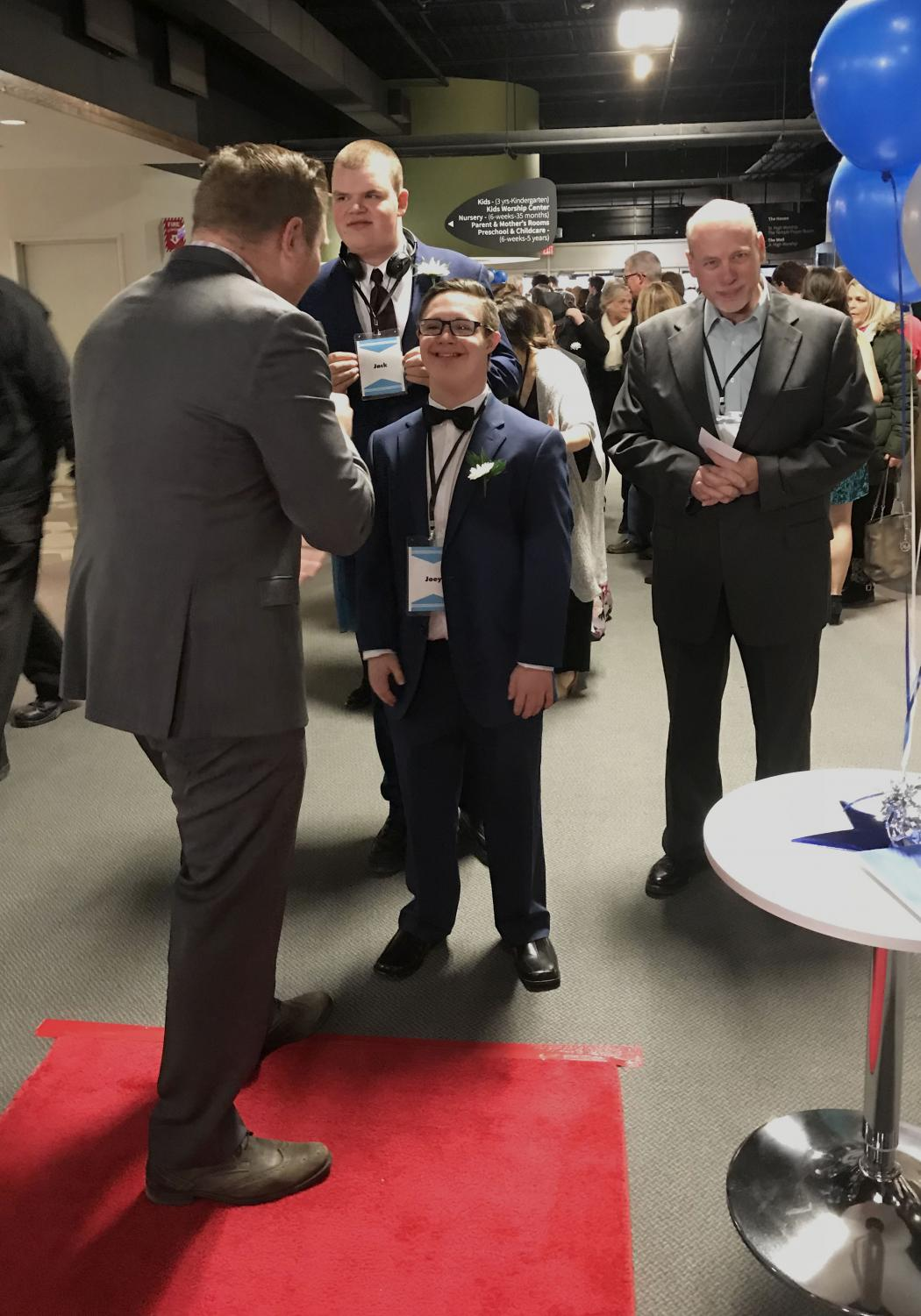 Smile beaming, junior Jospeh Drwal patiently waits for his turn to walk the red carpet. Every guest attending Night to Shine was able to walk the carpet while their name was announced.