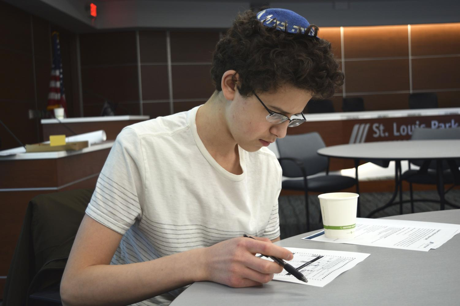 Junior Yoni Potter reviews sample ballots for the 2019 St. Louis Park municipal election which will utilize ranked-choice voting for the first time.