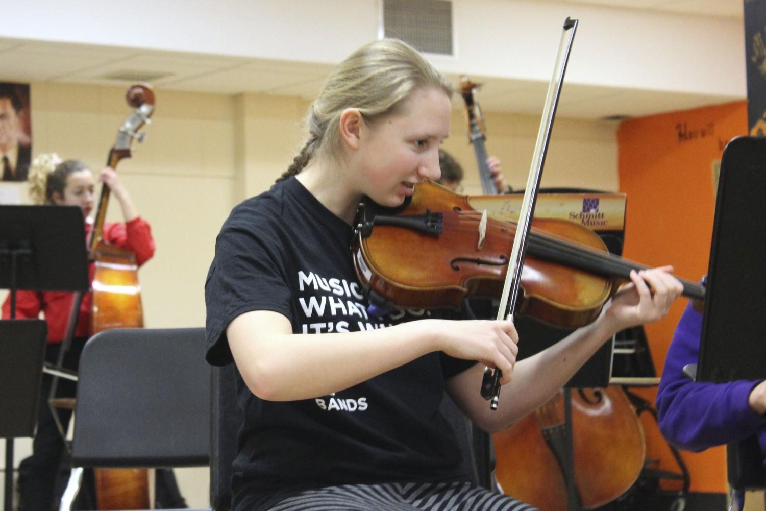 Sophomore Amara Foner plays the viola at Orchestra practice Friday the 15th. This is one of six instruments that she plays as well as composing the score for a musical.