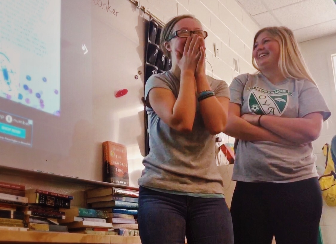 "Jordan Branson, freshmen, and Crawford laugh along with the rest of the combined class as Branson reads their collaborative story aloud. ""[Branson] thought everything was funny so it really made my day every time I saw her. Just her laugh was so contagious,"" Crawford said."