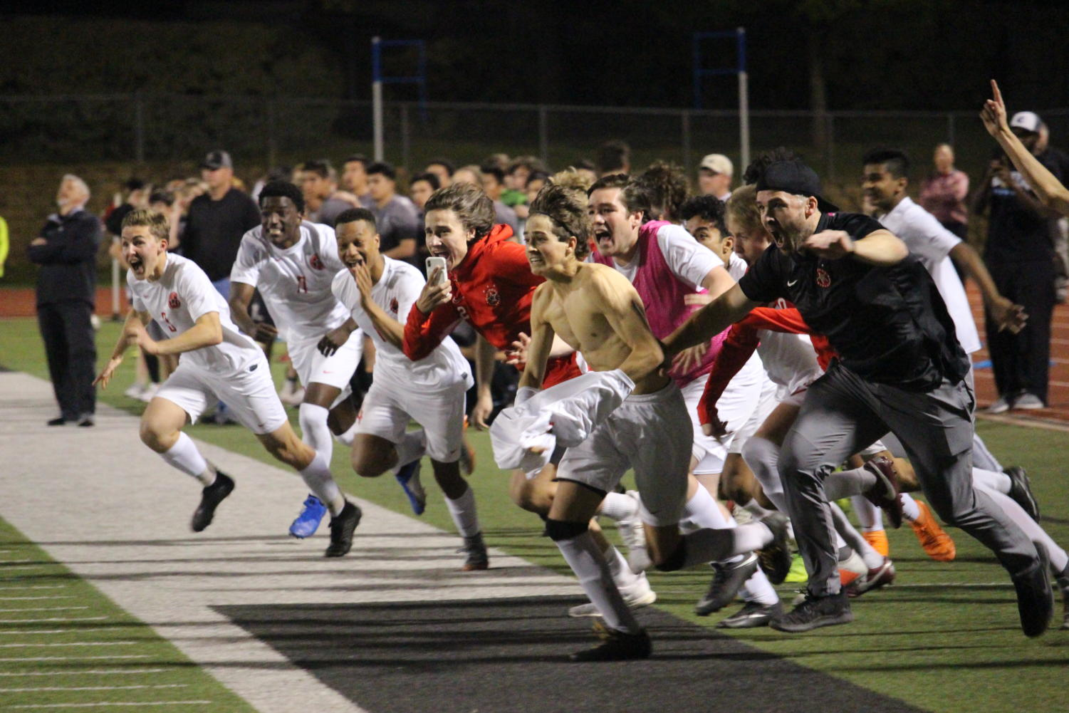 The Coppell boys soccer team celebrates after senior goalie Austin Simigian blocks Denton Guyer's Penalty kick to steal the victory for the Cowboys at Falcon Stadium in Lake Dallas. After a scoreless regulation and two overtime periods, Coppell won,  0-0 (4-3), in the Class 6A Region I bi-district match