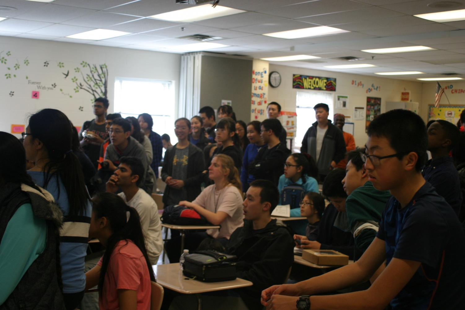 Students celebrate at the Pi Day Puzzle Hunt closing ceremony on March 15.
