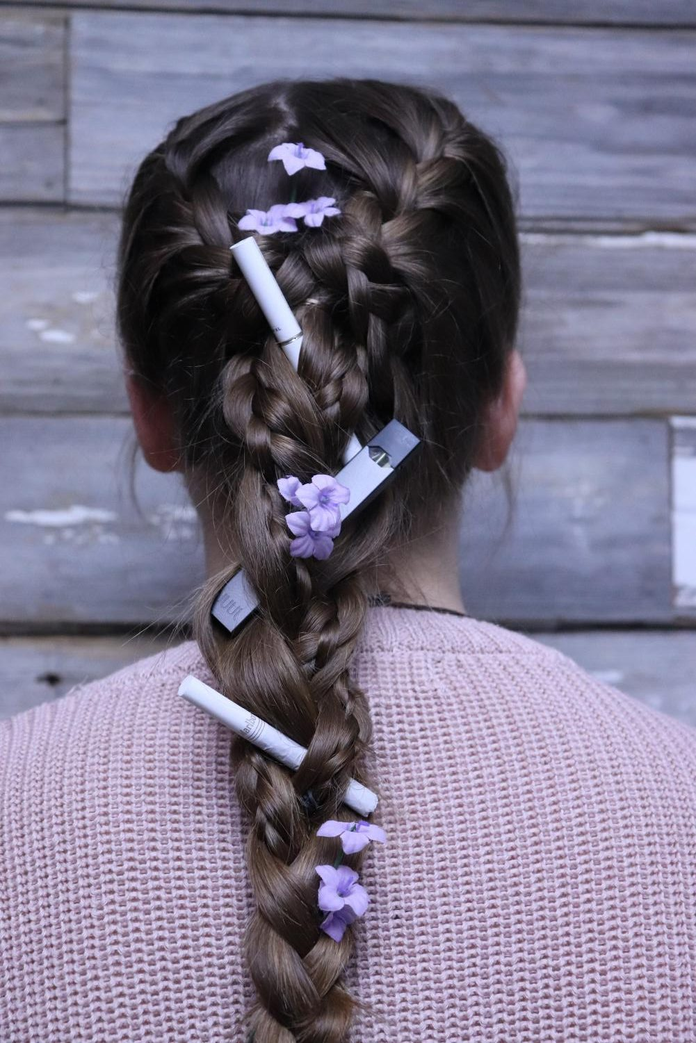 Freshman Ariana Nikolov is seen with cigarettes and a Juul tied in her hair to represent the addiction one can be tangled in.