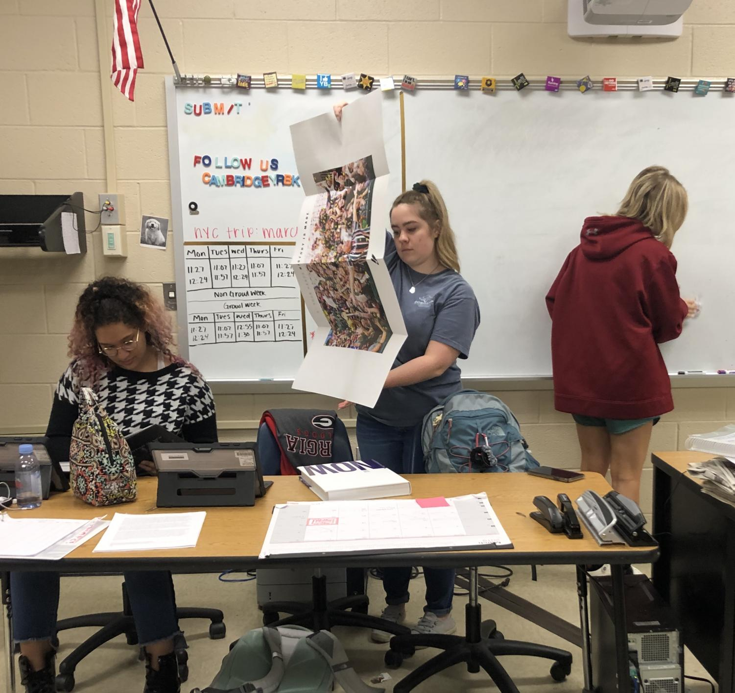 Yearbook staff members hard at work designing, publishing and submitting their book.