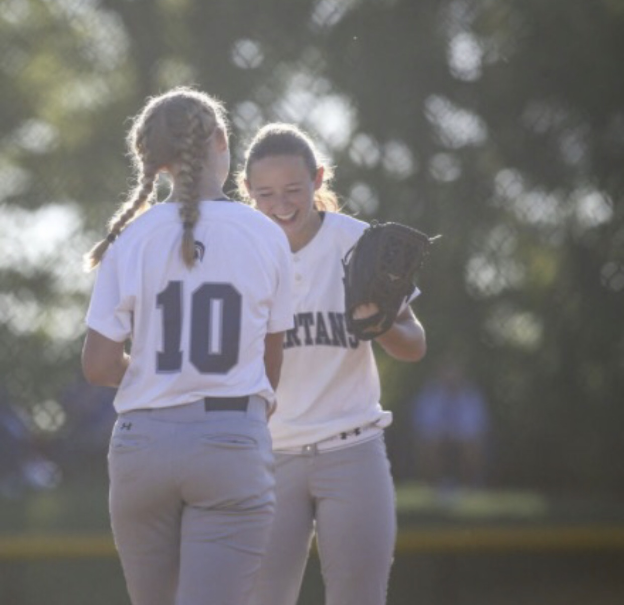 Ellie and Carli Spelhaug celebrate together after a conference play win in June of 2018. The two athletes went on to lead their team in becoming back-to-back state champions.