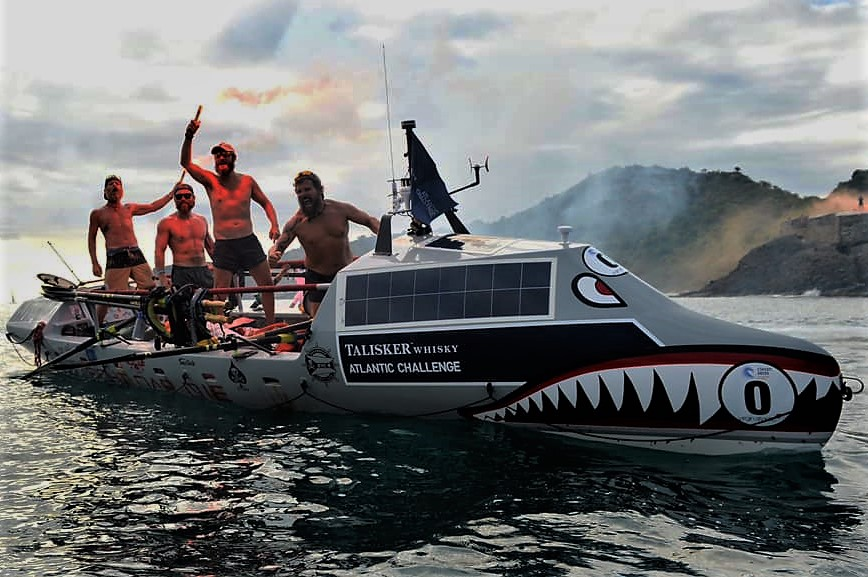 The+all-American+Military+Veteran+team+%E2%80%9CFight+Oar+Die%E2%80%9D+celebrates+as+they+finish+the+Talisker+Whiskey+Atlantic+Challenge+from+the+Canary+Islands+to+Antigua.