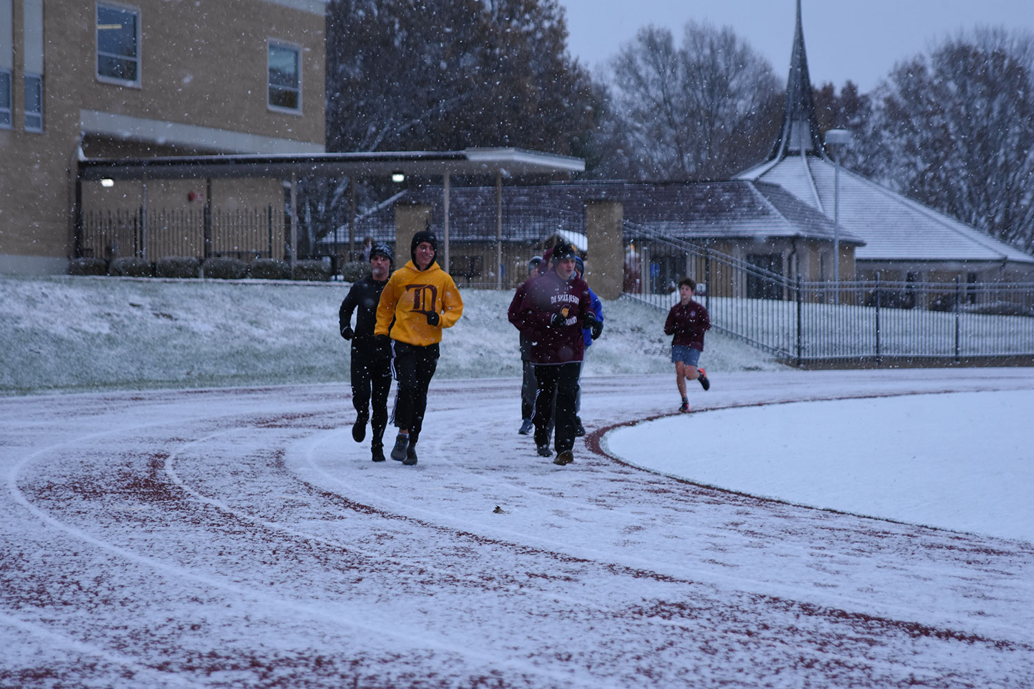 A group of runners led by Assistant Varisty Track Coach teacher Adam Boehm, run on a snowy day. The group runs throughout the winter preparing for the upcoming track season.