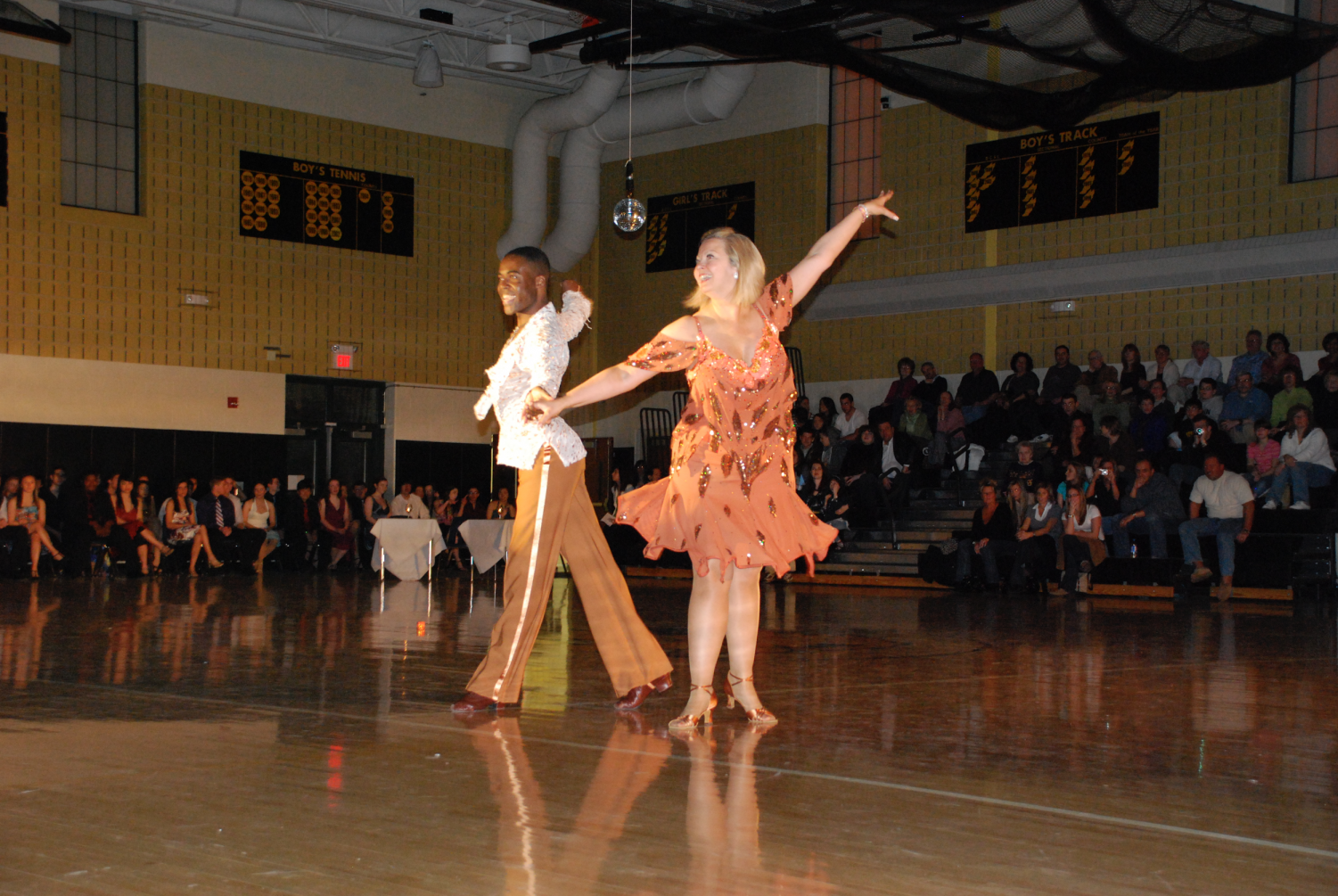 Jean Michel Erole, Ms. Muller's dance teacher and partner, and Ms. Muller perform at Dancing With the Stars