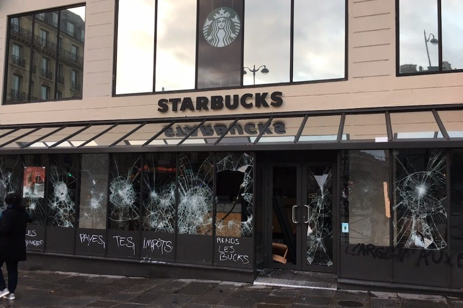 VIOLENCE%3A++++A+Starbucks+outside+the+St.+Lazare+train+station+was+vandalized+and+looted+on+Dec.+8%2C+with+inscriptions+on+the+store+saying+%E2%80%98Pay+your+taxes%E2%80%99+and+%E2%80%98Return+us+the+money%E2%80%99.