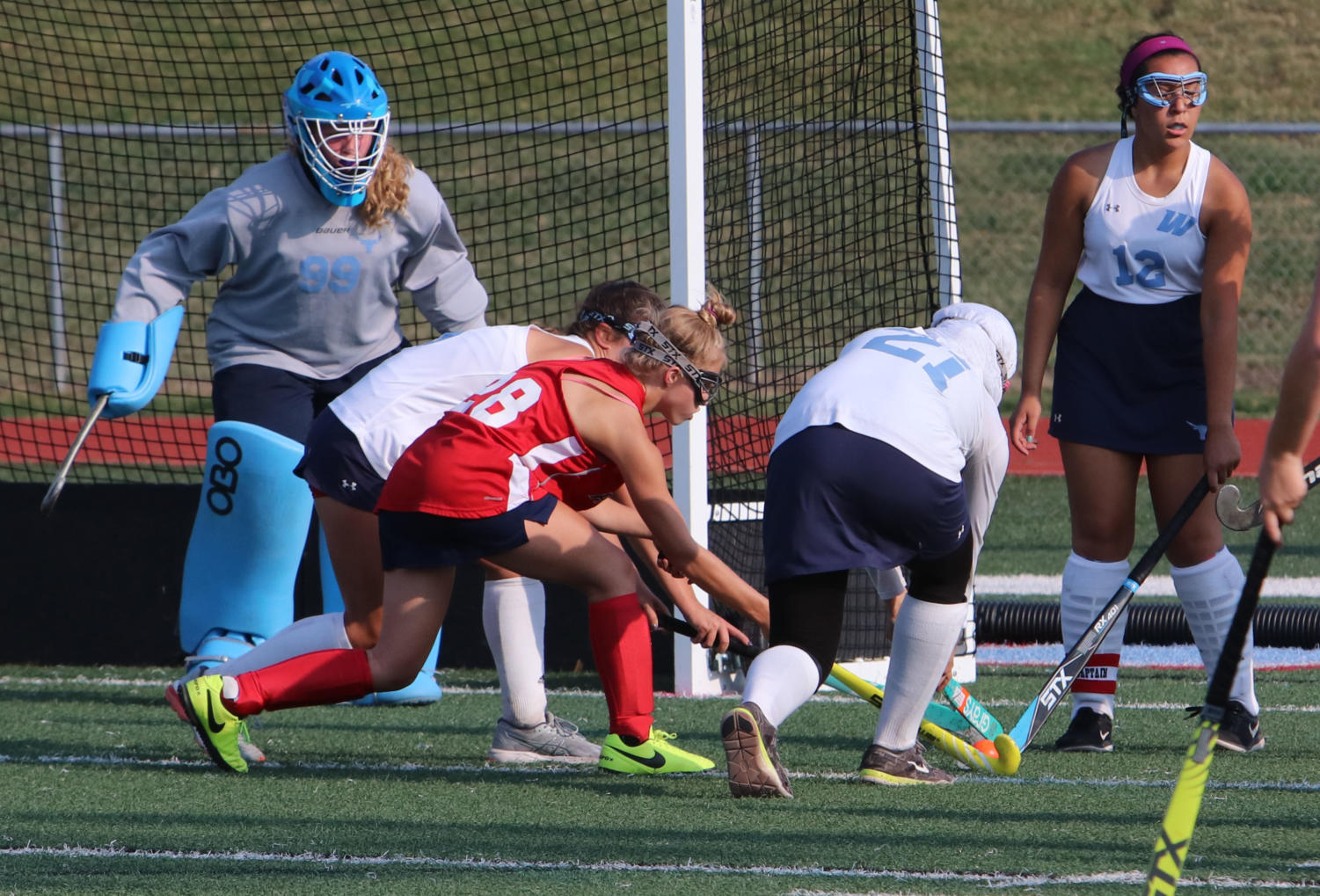 """During a game against the Lindbergh Flyers, sophomore Karen Trevor-Roberts guards her goal. """"I do everything to make sure the ball doesn't get into the goal, even during practice when a lot of balls are being shot against me,"""" Trevor-Roberts said. """"[Field hockey] gives you a family. It teaches me teamwork and even helps with social skills. It also teaches me how to balance school and sports."""""""