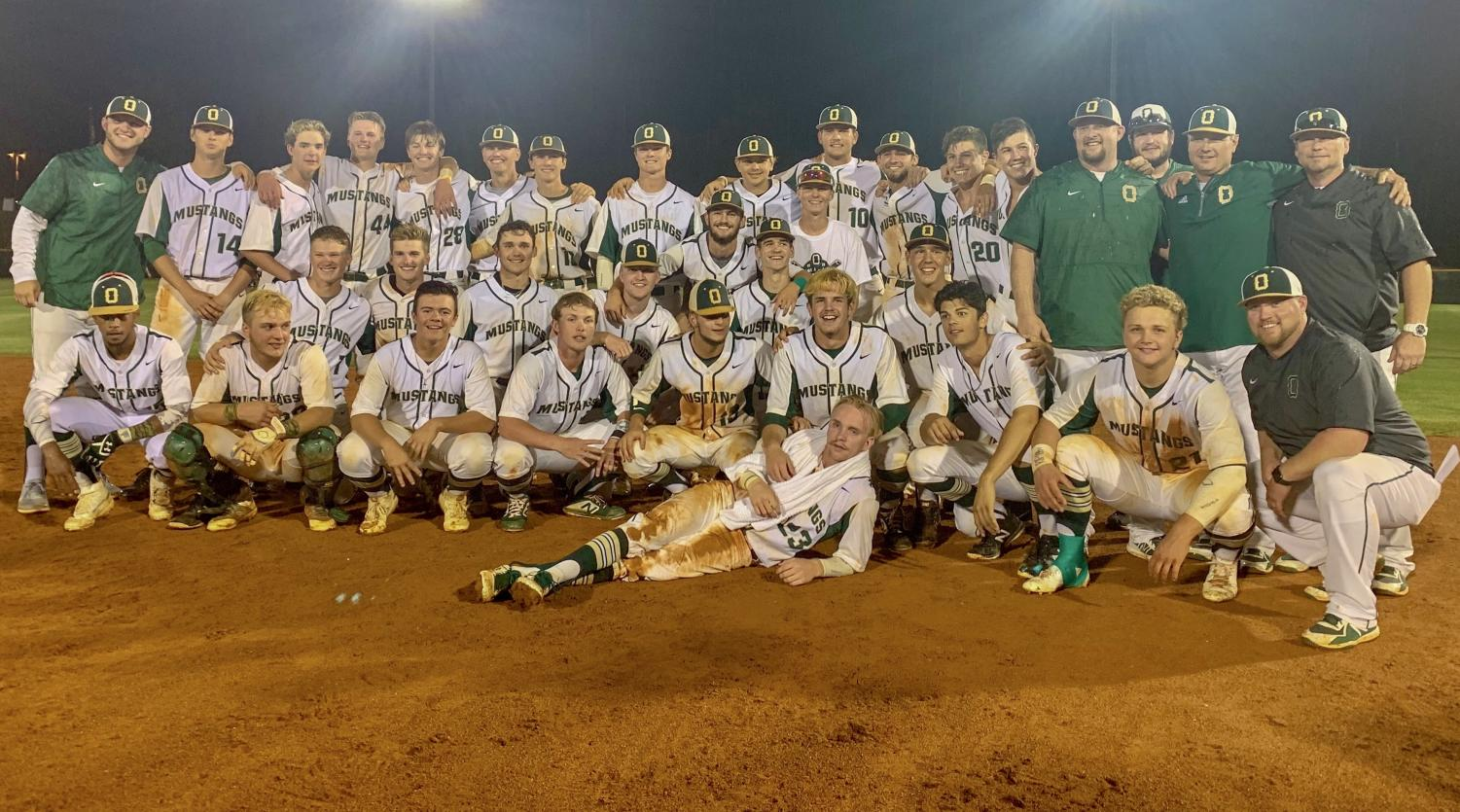The Mustangs gather for a picture after the win. The players made history advancing to the Final Four State playoff.