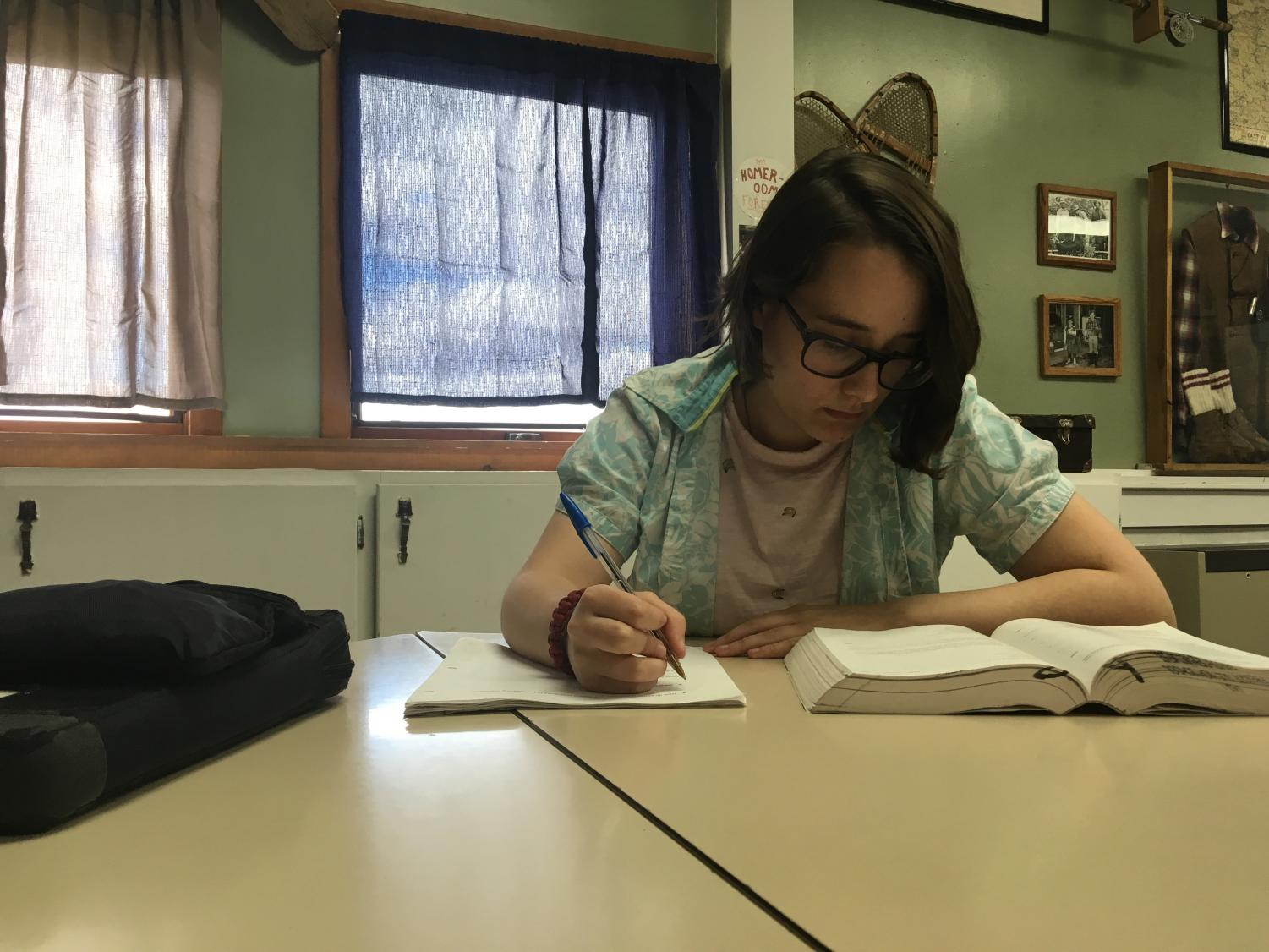 "Teachers have noticed that more students don't have time after school for extra help because of after school jobs. Acacia Johnston '19 works on homework during her period 6 study hall. She has to be at work for 2:45. ""It's a fun, easy job,"" Johnston said."