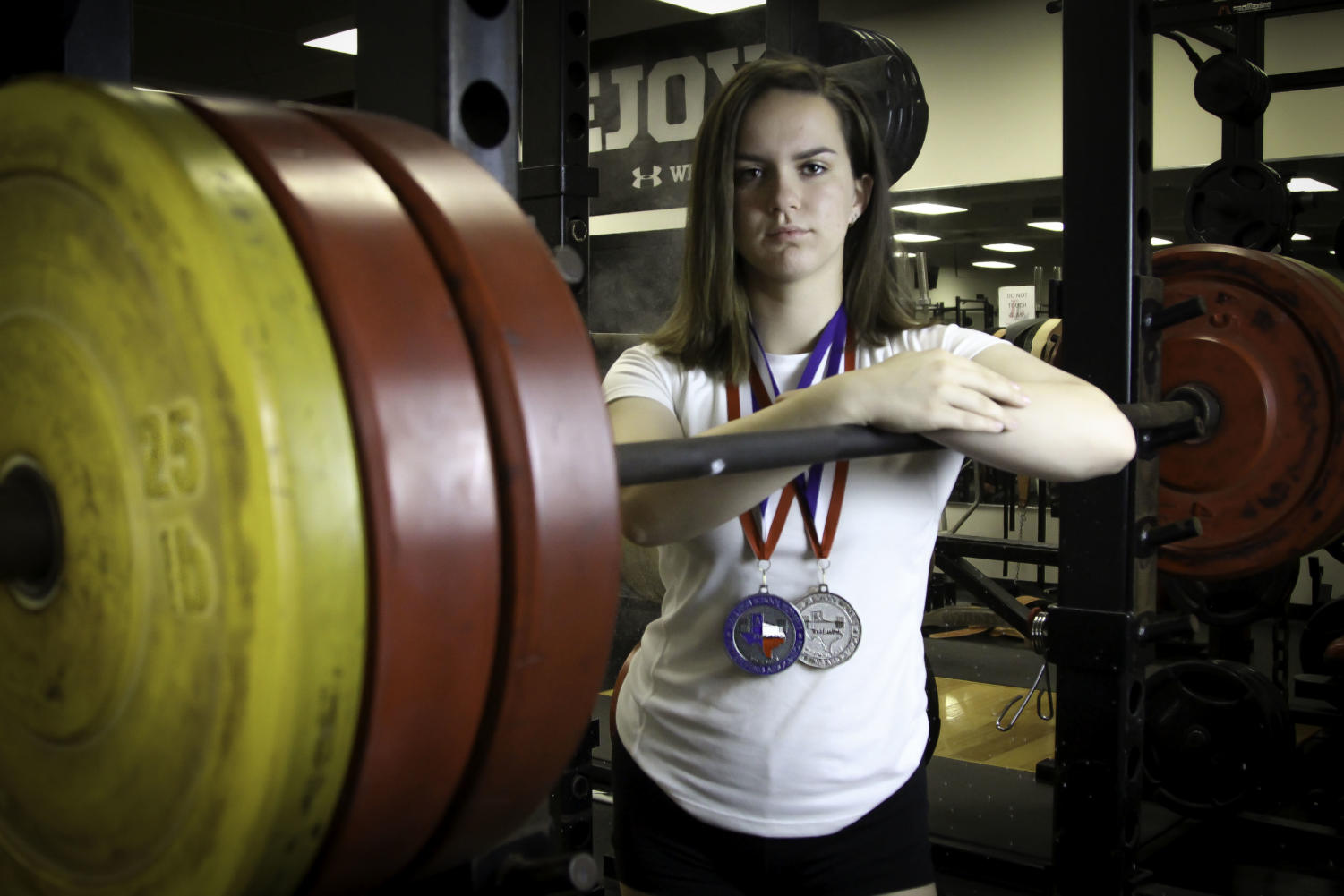Senior Ally Carraway transitioned from volleyball to powerlifting and became the 5A state record holder in the bench press for her weight class this season.