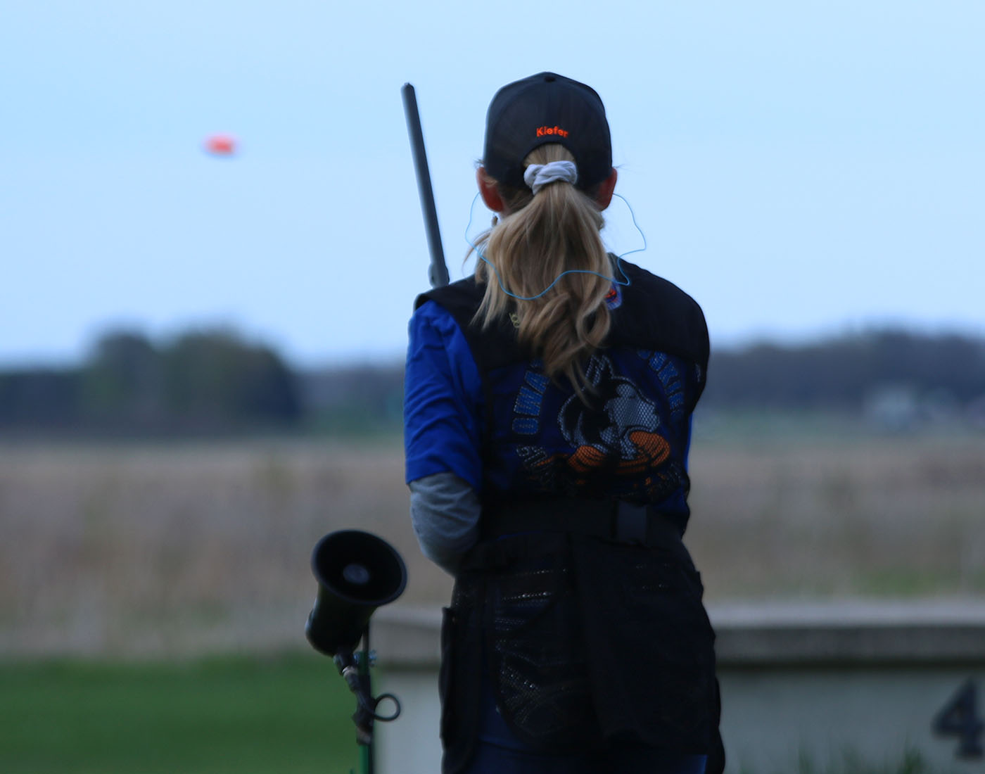 Jaci Burtis takes aim at a flying clay at  trap practice